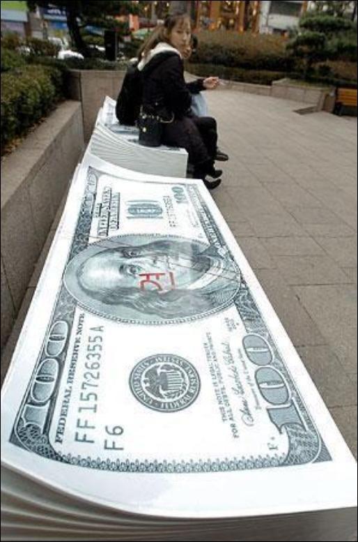 7/06/2008 dollar.......... Publicite-argent